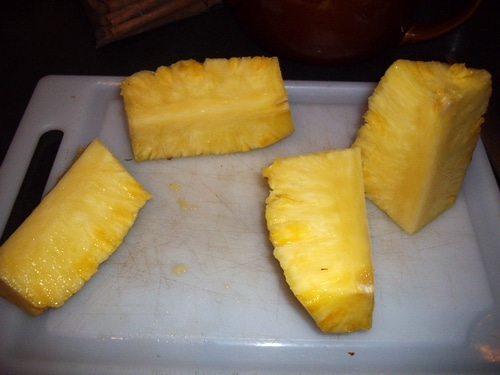 Cut the pineapple into quarters.