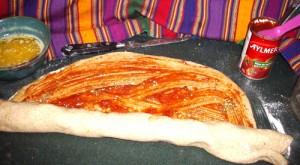 Pizza Twist Bread spreading tomato paste