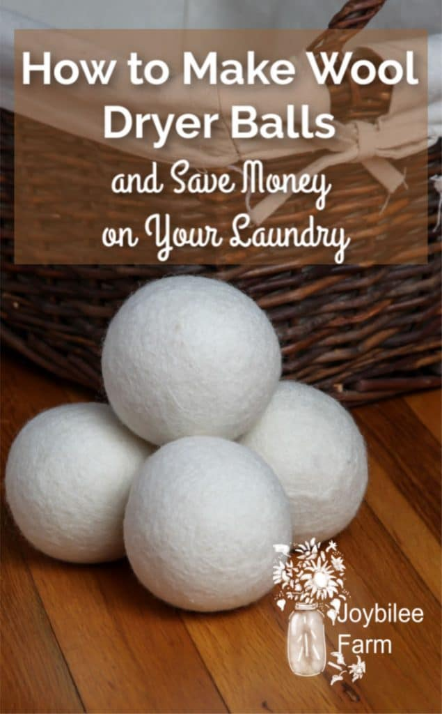 wool dryer balls in front of a wicker laundry basket
