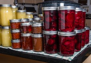 Preserved foods in mason jars on a counter