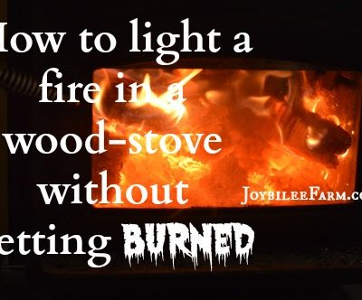 How to light a fire in a wood-stove without getting burned