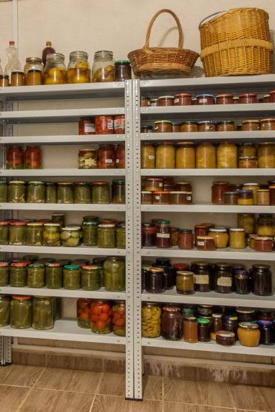 Pantry shelves full of canned food