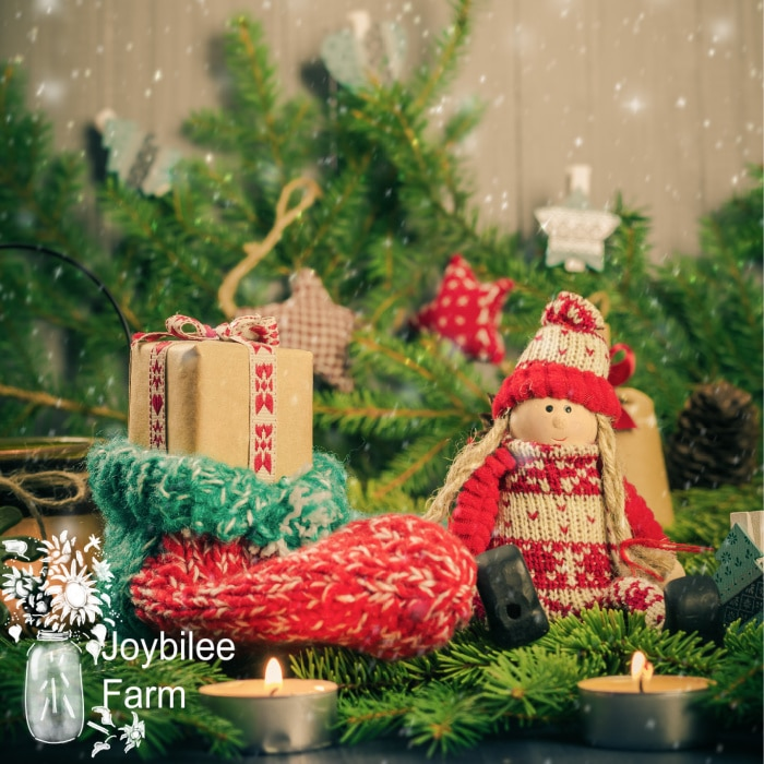 Christmas gift in handmade sock. Doll and decorations of pine needles