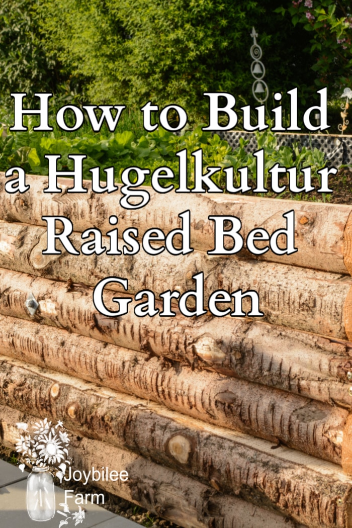"side of a raised wooden bed with text ""how to build a hugelkultur raised bed garden"""