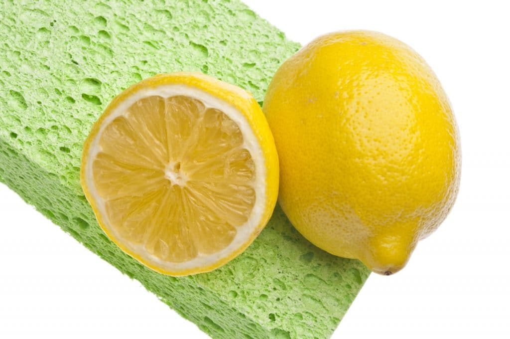 lemons and a sponge are the main ingredients in natural cleaner