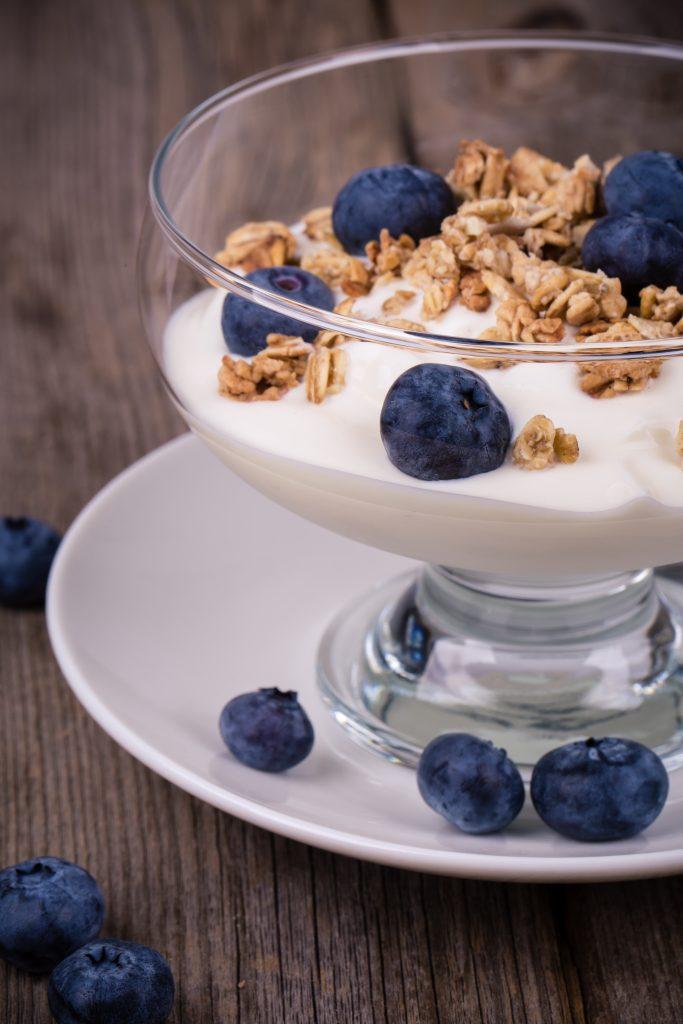 Yogurt with granola and fresh blueberries