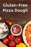 Pizza dough and ingredients on a wooden background