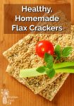 Sesame crackers stacked with a cherry tomato and celery on top