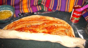 Pizza Twist Bread spreading tomato paste