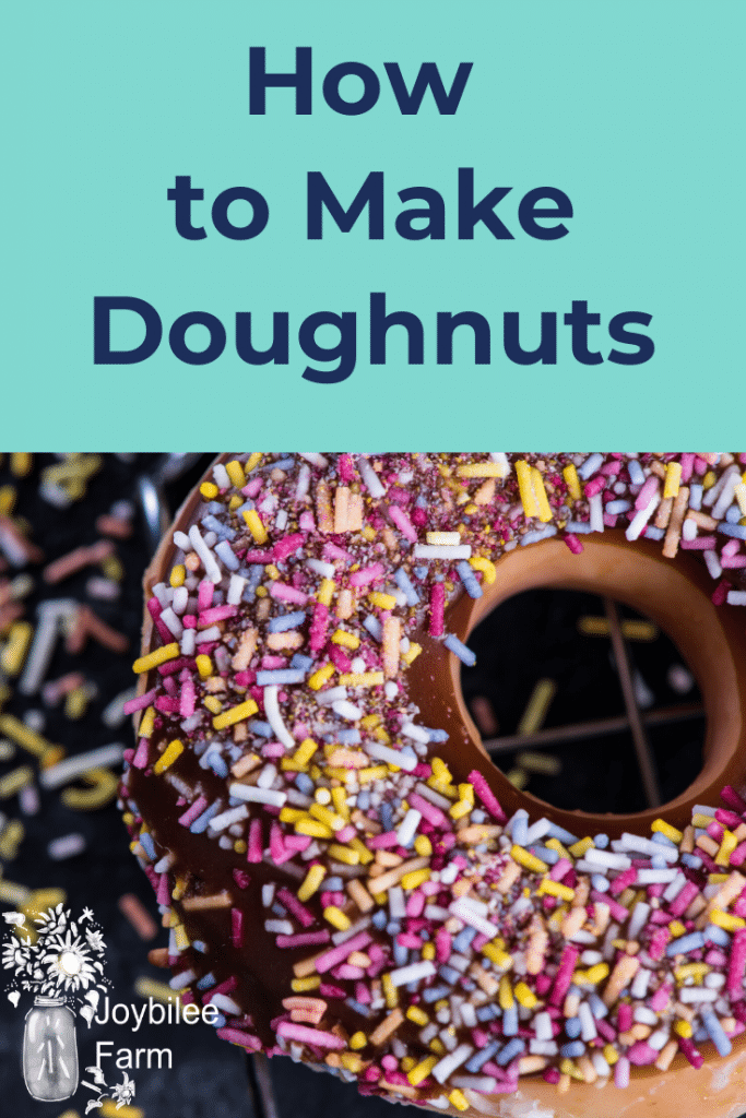 A chocolate glazed doughnut with colorful sprinkles