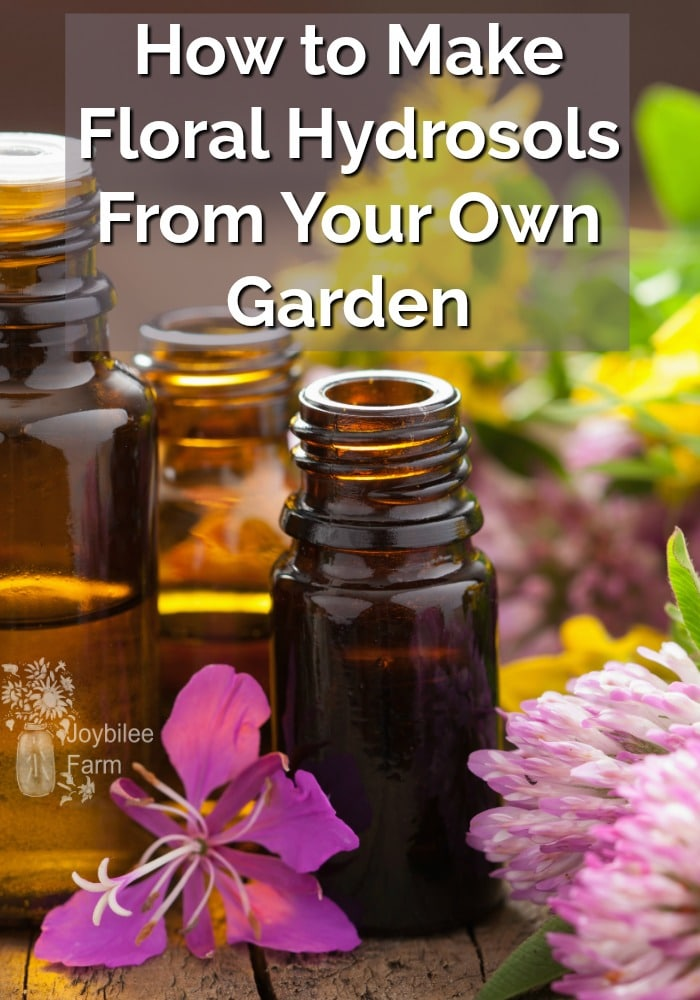 Essential oil bottles and a variety of fresh flowers