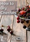 A colander of fresh cherries spilling over