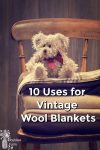 A teddy bear sitting on a pile of wool blankets