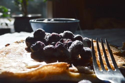 blueberries on top of sourdough pancakes