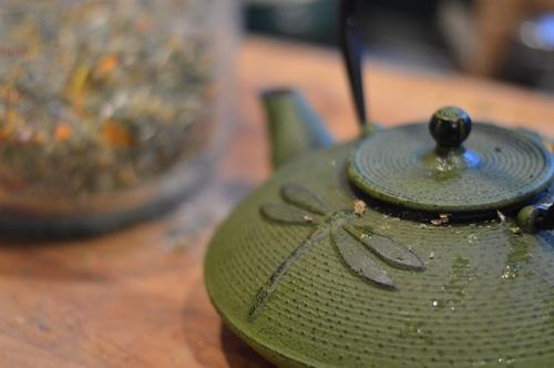 tea pot and a mason jar of homemade tea leaves