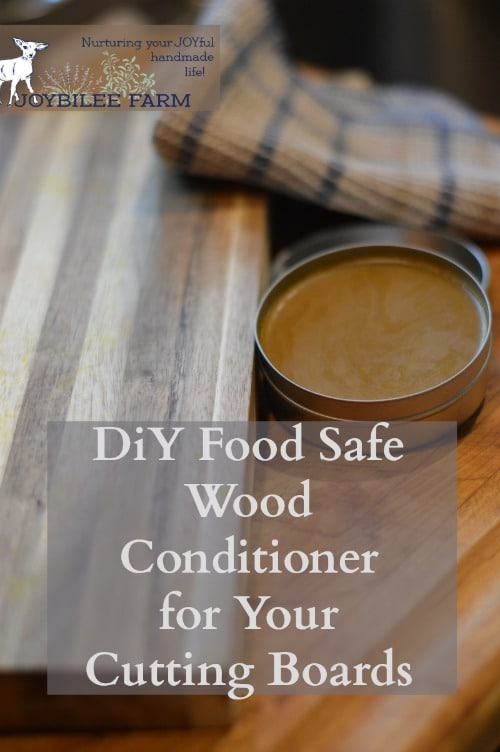Cutting board with a tin of wood conditioner and a rag