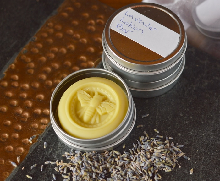 Lavender lotion bars are made with just a few ingredients but they offer long lasting protection for dry, cracked heels, rough elbows, and calloused hands. Here they are made better through the use of lavender infused oil.