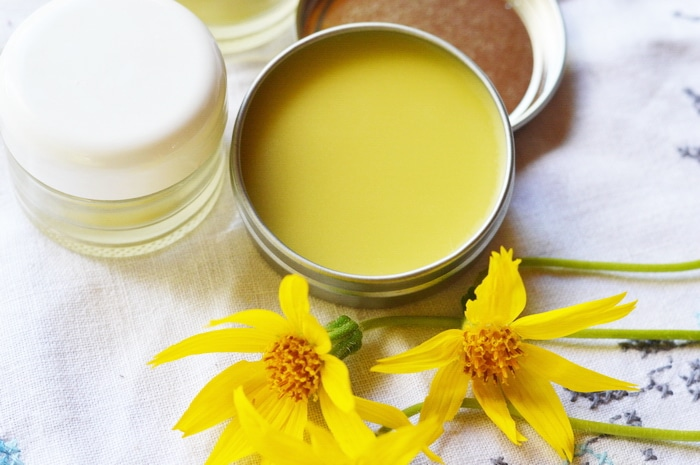 arnica salve in a tin jar