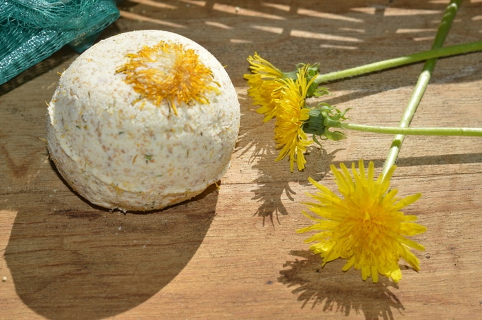 dandelion flowers with a bath bomb - Use these dandelion bath bombs when you need relief for achy muscles and sore joints.