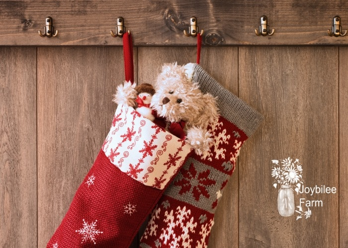 teddy in a stocking on a wooden background, stocking stuffers for women can be cute