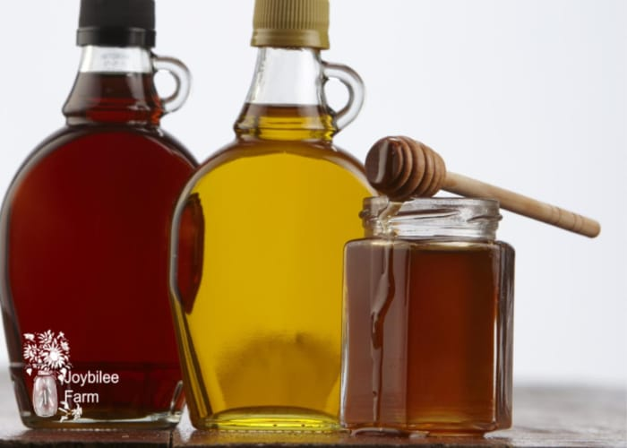 maple syrup and honey in jars