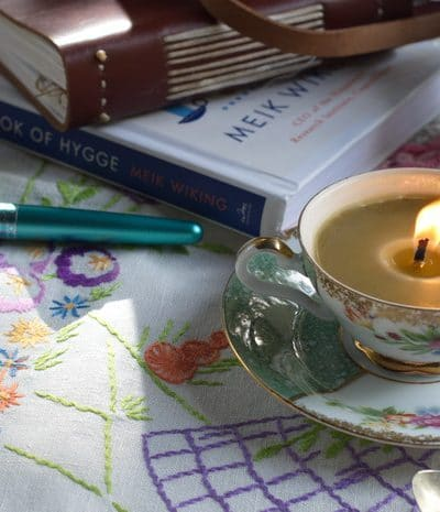 Teacup candle on a table