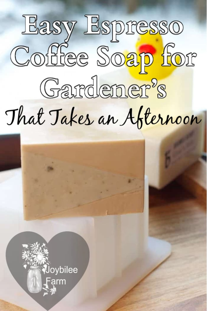 a bar of espresso coffee soap on a stack of glycerin soap base with soap in the background