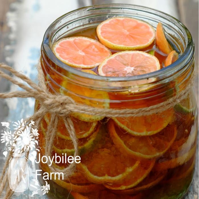 pink lemons in a jar of honey